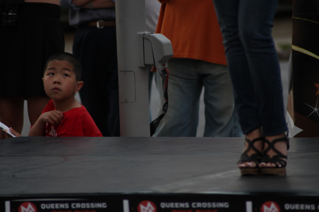 A young child watches the TVB USA Supernova Chinese-American singing competition in Flushing. New York, NY. 7:50 PM EST, Friday, June 21, 2013.
