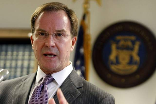 Michigan Attorney General Bill Schuette will defend Proposal 2, which changed the state constitution to ban affirmative action in public education, before the Supreme Court Tuesday. (Picture via Detroit Free Press)